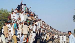 На поезде.