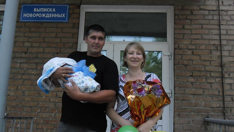 Алексей и Наталья Герасимовы с младшим сыном.