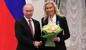 Владимир Путин и тренер Этери Тутберидзе.