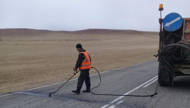 Дорожные работы в Хакасии.